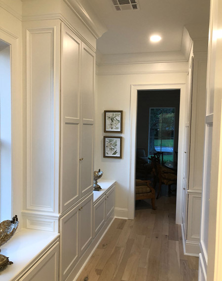white built ins in a hallway
